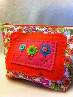 Small zipper pouch with hand embroidery by Tiffany, via Flickr