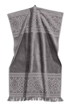 Hand towel: Hand towel in cotton terry with a jacquard-weave pattern. Hanger on one short side and fringes at the bottom.