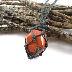 For Him: handsome macrame necklace with a wild red jasper pendant to increase power, strength, endurance and passion in the wearer!                                                             RED JASPER, the sacred friend.    Jasper is known as the 'supreme nurturer',  Red Jasper is also considered sacred by some Native American cultures. It is a grounding stone. Furthers the knowledge of the connection between humans and nature. This calming crystal may induce relaxation, contentment…