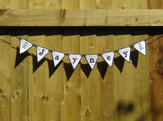 Customised flag bunting made to order. Perfect for a child's room This would also make a lovely gift for newly-weds, you can also add their names and the date they married. If you sell at craft fairs, Markets, etc why not have you business name and logo made in to bunting. The banner flags are made from felt and measure 10cm wide at the top by 10cm high. Blank flags, or flags with hearts can be added at each end. Please add this request in with your order Different colour hearts are…