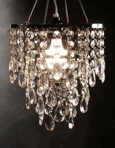 Crystal Chandelier Lighting 3 Tier Plug In $50 to replace the light in the kitchen area above the desk.