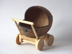 Wooden Baby Doll Carriage - Natural Eco Coconut shell Waldorf toy Stroller - Childrens toy with moving wheels. $51.50, via Etsy.