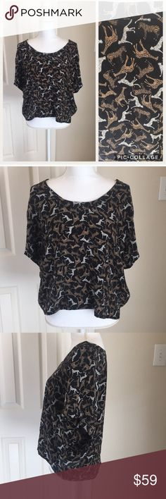 Joie 100% Silk Jungle Blouse Gorgeous Joie blouse- 100% silk, Boxy fit.  Has wide armholes and hem is slightly longer in the back.  Jungle print features giraffes, zebras, and cheetahs.  EUC!  See pictures for measurements. Joie Tops Blouses