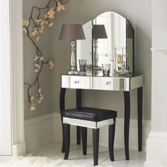 I believe I need a cute little dressing table such as this.