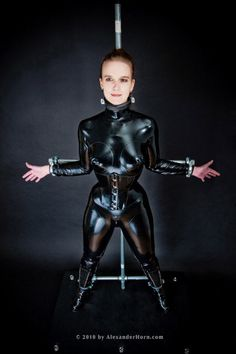 Sweating into her latex catsuit