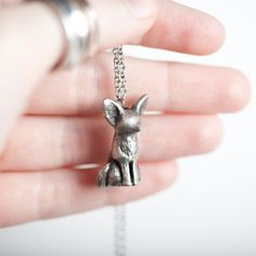 "Carry le playful fennec fox with you and channel his limitless energy. Stats: Spirit +12 Spontaneity +9 Friendship +11 Le fennec fox has made his home on a 20"" stainless steel chain. This is a pewter"