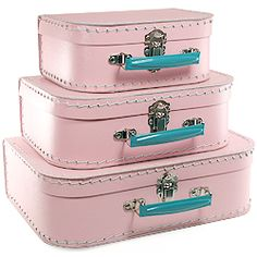 pink and teal vintage suitcases