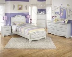 For the princess in your life. With the silver pearl finish of the 3D press technology creating smooth edges and a unique design along with the flowing button tufted upholstered headboard adorned with faux crystal buttons.