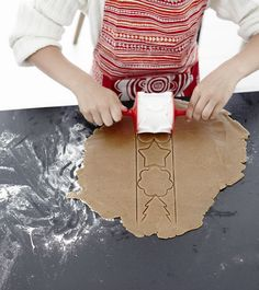 A girl wearing a red apron uses a pastry cutter to make cookies from gingerbread dough. Gingerbread Dough, Red Apron, Baking Set, Cooking Equipment, How To Make Cookies, Kitchen Essentials, Bakeware, Kitchen Tools, Kitchen Accessories