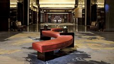 In just 52 seconds, guests are transferred to the reception lobby on the 103rd floor. They are amazed by a classic Chinese watercolor artwork depicting running horses.
