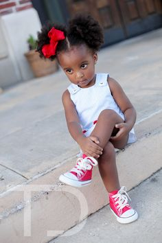This is what my daughter will look like (only not as dark!) Little puffs and chucks! I LOVE IT!!! @Jess Liu White