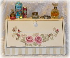 Vintage Bread Box MakeUp Storage Shabby Cottage Chic Vanity Organizer Hand Painted Roses. $40.00, via Etsy.