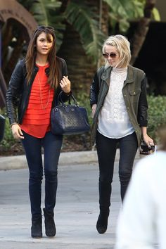 Julianne Hough with Nina Dobrev. Casual street style, booties, jeans and jacket.