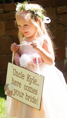 Could this @Mandy Dewey Seasons Resort Jackson Hole sign and flower girl be any sweeter?