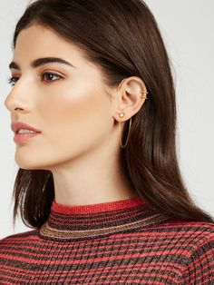 The ultimate edgy earring collection: Pile on hoop ear cuffs, petite studs and the centerpiece, a chained ear cuff. Set includes 6 ear cuffs, one pair of studs and one ear adornment.