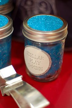 Glitter playdough in jelly jars.