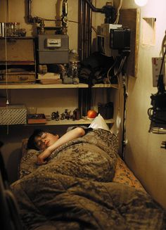 Harry Potter in his cupboard. ~ Harry Potter and the Sorcerer's Stone