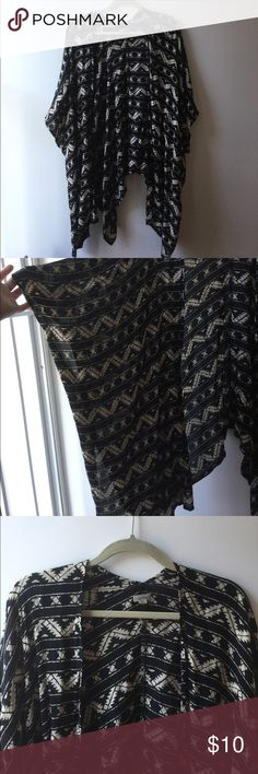 Ecoté short sleeve black and white kimono size M/L This is from Urban Outfitters! It's pretty opaque and the front is longer than the back. It's very drapey and lightweight and basically goes with anything! SUPER comfy too! Ecote Tops Tunics
