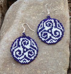 These earrings are beautiful in contrasting colors done in purple and white glass Delica beads in a Peyote Stitch. Very light weight. These southwest earrings are 2 long and 1 1/4 wide with french hooks.  I love the design and roundness of the earrings with a very noticeable shape and color. Its not a traditional shape for beaded earrings but they are fun to wear.  They would make a great gift or treat for yourself.  Thank you for stopping by, please come again. Have a great day