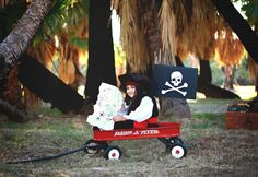 "Cut paper Jolly Roger flag, photo by Brittney Williams for the play structure ""pirate ship"""