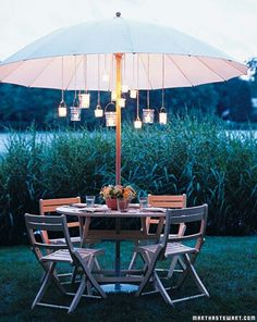 Outdoors meal with hanging lanterns. Cute!