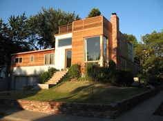 Modern Brick House With Two Story Window Modern House