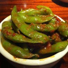 ANGY EDAMAME  Kona Grill Copycat Recipe   Serves 2   1 (12 oz.) bag frozen unshelled edamame  3 garlic cloves, minced  4 teaspoons grate...