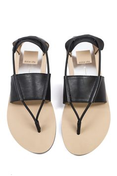 I pair my Dolce Vita black leather sandals with harem pants and a linen tee.