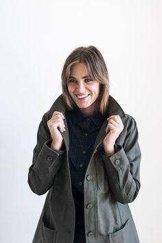 A Modern Chore Coat Made to Grow with You The best thing about fall is the coats, and we're thrilled to bring you The Robyn in Moss, after adding it to the Tradlands collection last year in Carmel and