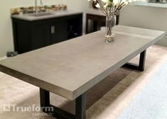 Contemporary dining table with a concrete table top and steel base. Concrete Table Top, Concrete Kitchen, Concrete Overlay, Custom Dining Tables, Contemporary Dining Table, Contemporary Home Decor, Dining Table In Kitchen, Patio Table, Table Lamp