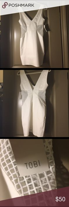 Cute fun white dress. NWT!! Mesh cut out sides! In perfect condition. Never worn. Brand new. No longer available from Tobi. Tobi Dresses Mini