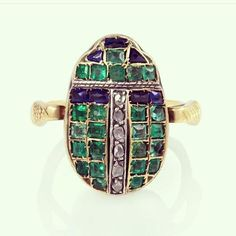 Art Deco scarab ring with serpent shoulders, emeralds, diamonds and sapphires