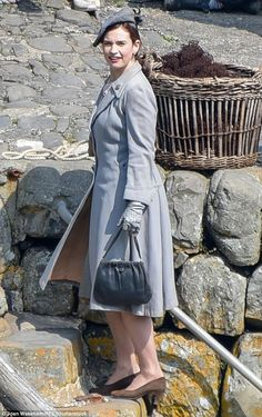 Prim and proper:With a pair of gloves and a ladylike handbag, Lily looked incredibly proper as she filmed scenes for the new movie