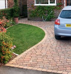Permeable block paving curved into path round side of house