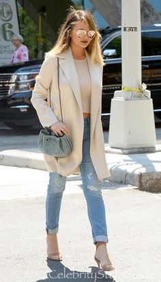 Chrissy Teigen and The Row Rallan Silk and Wool-Blend Coat, Chloe Inez Small Drawstring Bag, Victoria Beckham Classic Victoria Sunglasses, Stuart Weitzman Nudist 110mm Sandals. See the latest Chrissy Teigen style, fashion, beauty, trends, wardrobe and accessories.