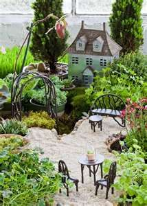 I MUST make a mini-garden! Tons of beautiful gardens on this site. Mini Fairy Garden, Fairy Garden Houses, Gnome Garden, Fairy Gardening, Garden Fun, Indoor Gardening, Garden Planters, Fairy Furniture, Enchanted Garden