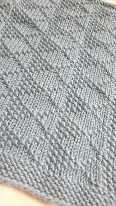 Free Knitting Pattern for Melanie's Blanket - Easy diamond patterned blanket easily customized to any size. DK yarn. Designed by Aurora Knits.