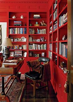 These red bookcases are so indulgent and they look great with the traditional furniture and fabrics. ~s