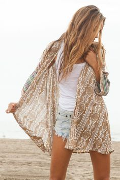 New spring and summer trend: shorts, plain tank top, and an intricate pattered or lace komono. Loving this