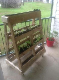 Balcony or patio garden made with pallets