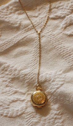 Vintage Antique Gold Locket Necklace. Can hold four by KLizVintage, $16.00