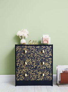 Add a pretty pattern to drawers by cutting wallpaper to size (leftover pieces and sample swatches work great!) and attaching with wallpaper glue. Click through for more IKEA hacks and dresser tips.