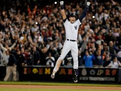 JULIE JACOBSON—AP Sept. 25, 2014. New York Yankees' Derek Jeter jumps after hitting the game-winning single against the Baltimore Orioles in the ninth inning of a baseball game in New York.