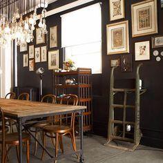 Dark walls + edison lights + bentwood chairs