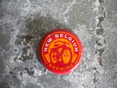 NEW BELGIUM Brewing Co. Ft. Collins, Colorado My bottle cap ART collection. Craft beer labels are the new record albums of old.