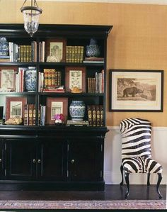 bookcase with covered shelves on bottom