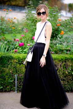 "The Blonde Salad shares her secrets: ""How to make money as a fashion blogger."" (Wearing a black tulle skirt with sleeveless white tank, monochrome bag, black watch, and cat-eye shades at Paris Fashion Week 2014)"
