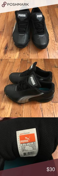 Women's Black Puma Sneakers Women's Black with silver accent sneakers in size 7.5. These are preowned but in good shape. Puma Shoes Athletic Shoes