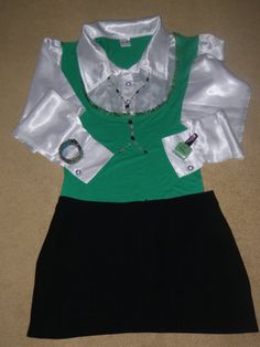 Wasze zielone stylizacje - Iwona!  :).  Do #konkursu na #najlepsza #stylizacja zaprasza www.big-active! Na zdjęciu stylizacja biało-zielonej bluzki, dopasowanej do figury, w połączeniu z czarną krótką spódniczką. Dodatkami są: zielony zegarek na rękę, zielony naszyjnik i oczywiście zielony lakier do paznokci, bez którego nie wyobrażam sobie całej stylizacji.