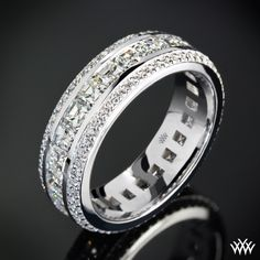 Cast in 18k White Gold, this stunning Custom Diamond Wedding Ring holds two rows of A CUT ABOVE® Hearts and Arrows Diamond Melee that flank a center row full of Asscher Cut Diamond Melee. The width of this ring is 6mm.